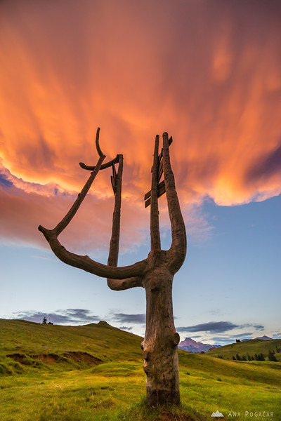 Fiery anvil cloud over Velika planina at sunset