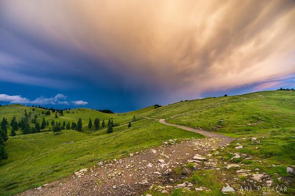 Stormy sunset clouds over Velika planina