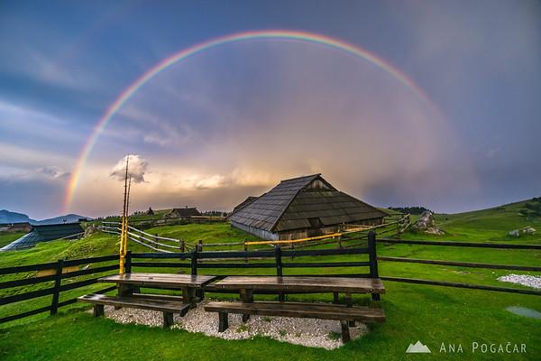 Storm and rainbow over Velika planina