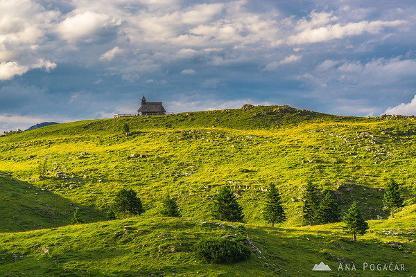 Chapel on Velika planina in warm late afternoon light