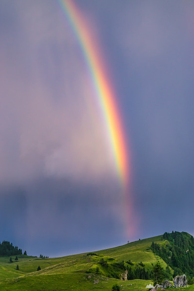 Storm and rainbow over Velika planina