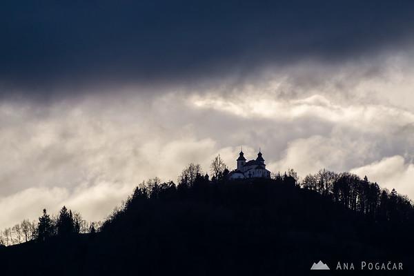 St. Jošt church and dramatic skies from Šmarjetna gora