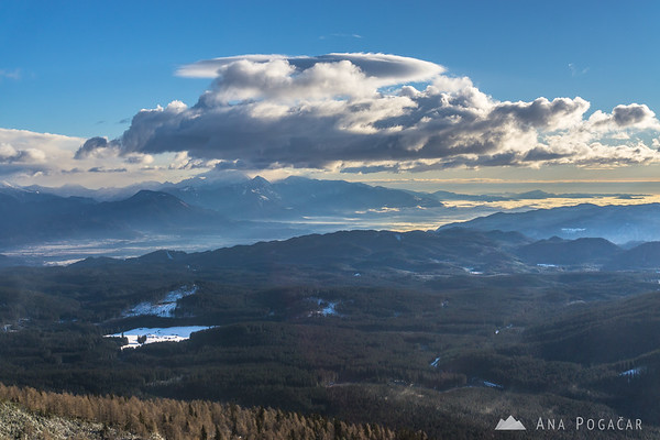 Winter ascent to Mt. Viševnik - views of Pokljuka plateau and the Kamnik Alps in the background.