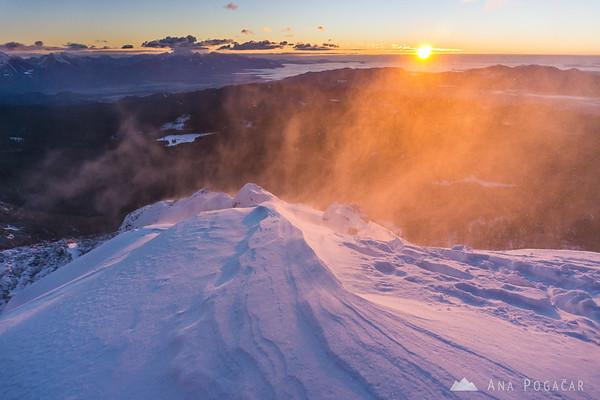 Winter ascent to Mt. Viševnik - windblown snow in the sun.