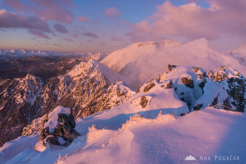 Winter ascent to Mt. Viševnik - pink Julian Alps.