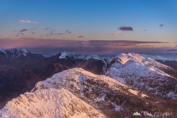 Winter ascent to Mt. Viševnik - pink Julian Alps: Mrežce and Debela peč.