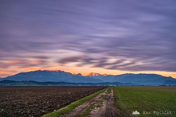 Long exposure photo of clouds over the Kamnik Alps at sunset
