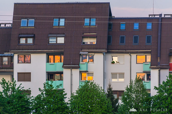 Sunset reflections in apartment building windows in Duplica