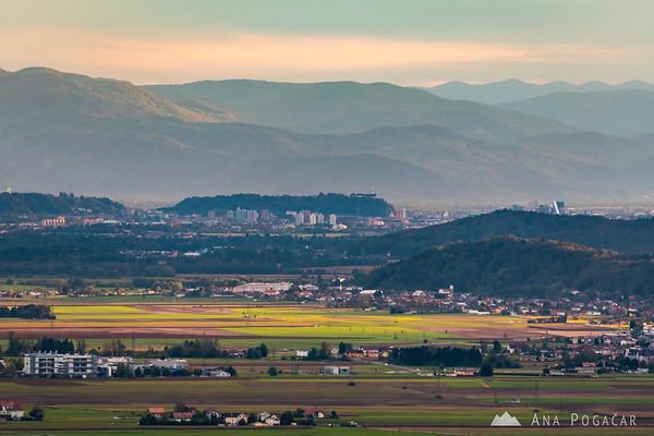 Dramatic afternoon light from Stari grad hill above Kamnik; Mengeš and Ljubljana in the distance