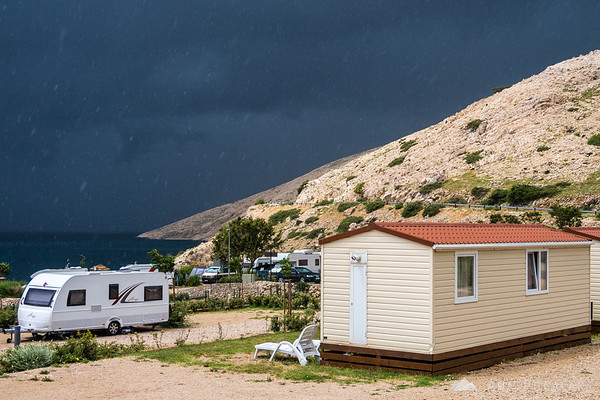 Ominous storm clouds at Škrila campground during heavy rain