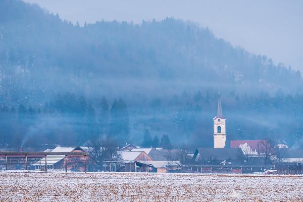 Village of Šmartno in light mist after sunset