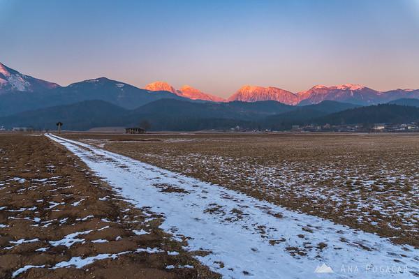 The fiery Kamnik Alps at sunset: Mts. Kočna, Grintovec, Kalški greben and Krvavec