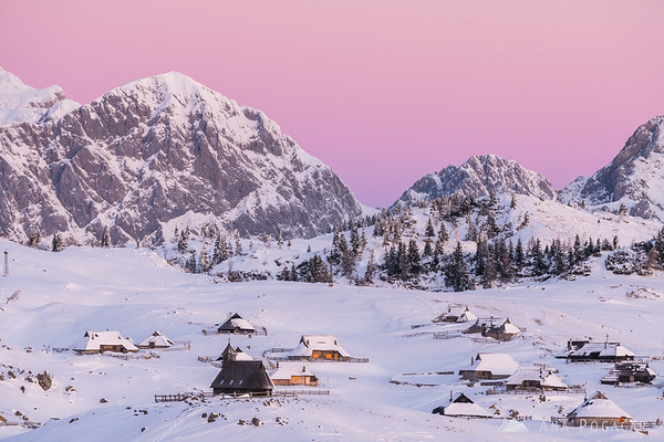 Pink sky above the Kamnik Alps and Velika planina before sunrise