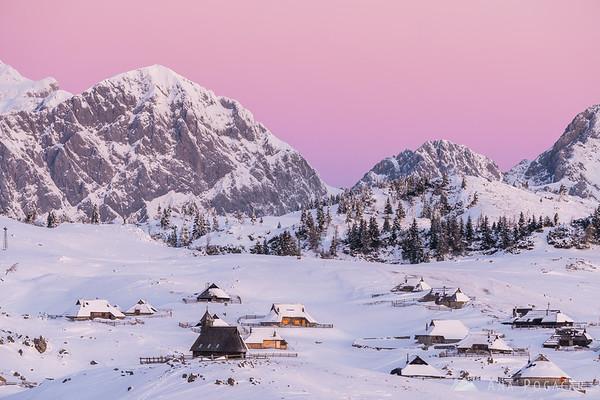 Pink sky above the Kamnik Alps and Velika planina before sunrise