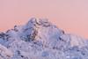 Pink sky above Mt. Ojstrica in the Kamnik Alps from Velika planina before sunrise