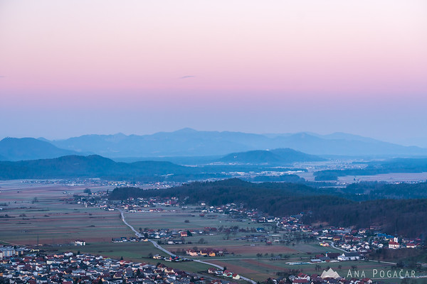 Pink light above the horizon in Kamnik just before sunrise