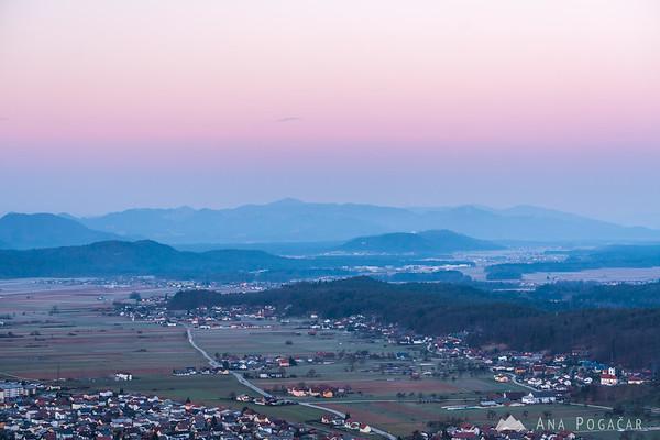 Pink light above the horizon in Kamnik just before sunrise