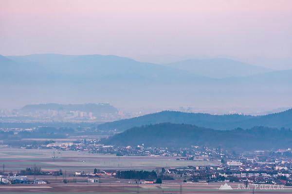 Views towards Trzin and Ljubljana from Stari grad above Kamnik in poor dawn visibility