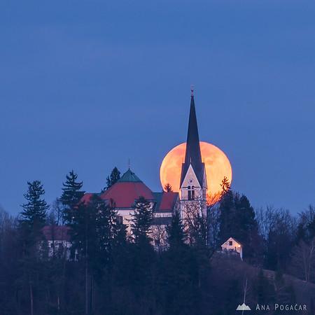 Full moon rising above Homec church