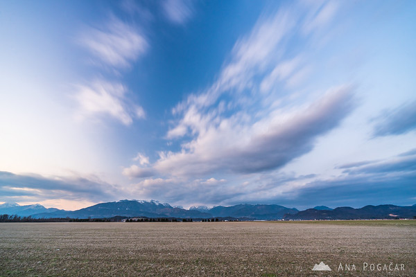 Long exposure of clouds moving over the Kamnik Alps after sunset