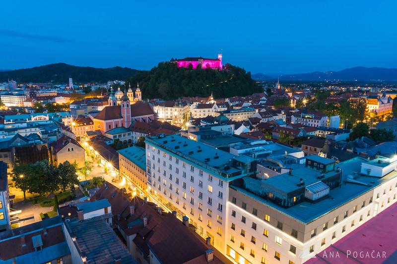 Ljubljana and its castle shot from the Nebotičnik (Skyscraper) terrace during blue hour