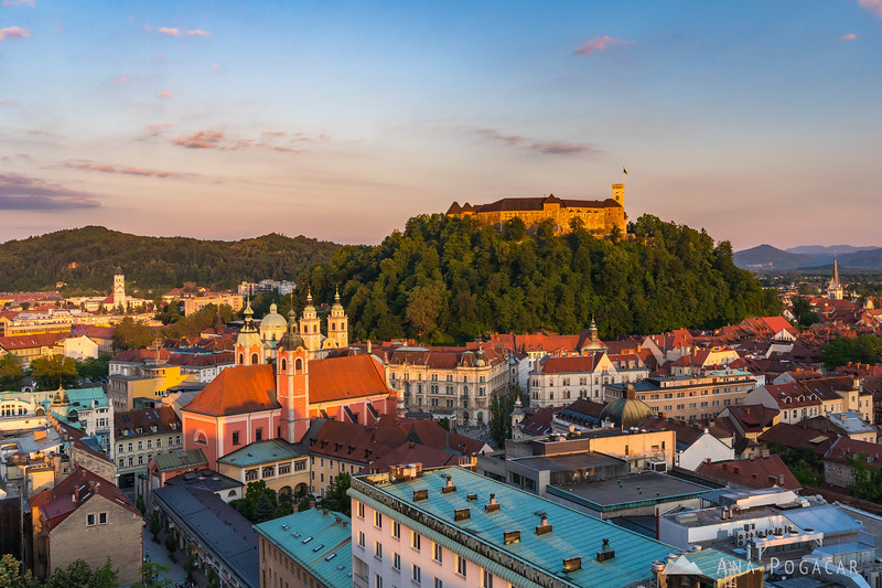 Ljubljana and its castle shot from the Nebotičnik (Skyscraper) terrace at sunset