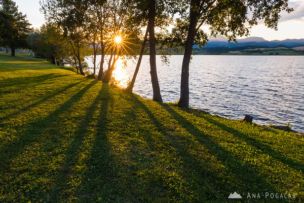 Sun rays and shadows at Velenje Lake