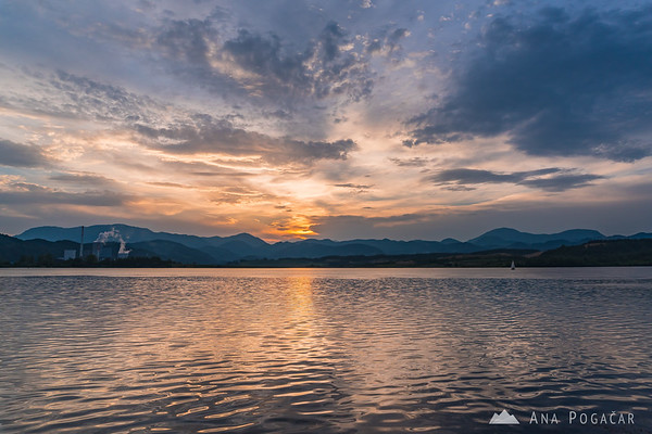 Reflections in Velenje Lake at sunset