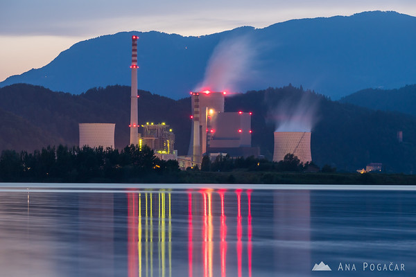 Šoštanj Thermal Power Plant reflected in Velenje Lake at dusk