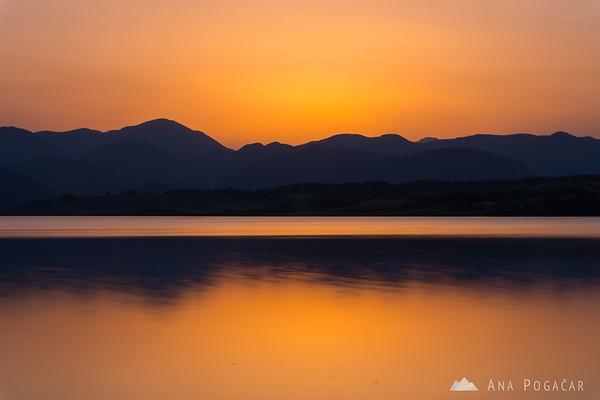 Cloudless sunset over Velenje Lake