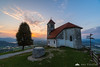 St. Ana church above Ljubljana Marshes at sunset