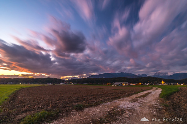 Long exposure of clouds above Kamnik after sunset