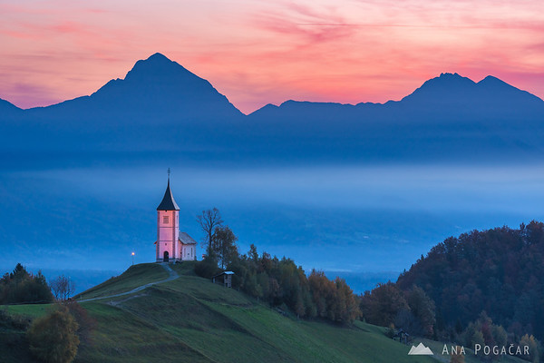 Church in Jamnik at sunrise, Mts. Storžič, Kočna and Grintovec in the background