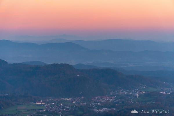 Views from the slopes of Mt. Kamniški vrh towards Kamnik at dusk
