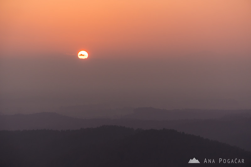 An extremely smoggy sunset from Stari grad hill above Kamnik