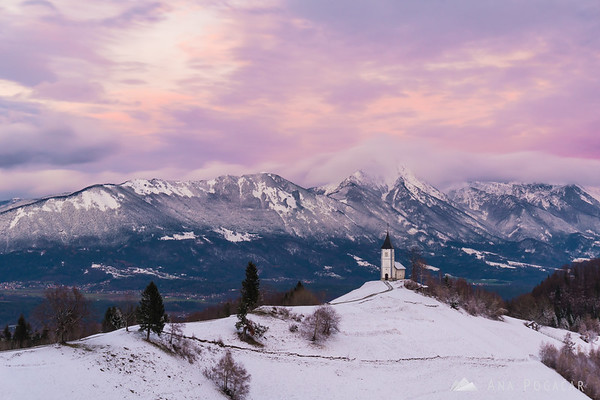 Sunset colors in the sky above Jamnik and the Kamnik Alps