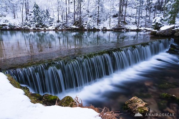 At the source of the Kamniška Bistrica river on a snowy day