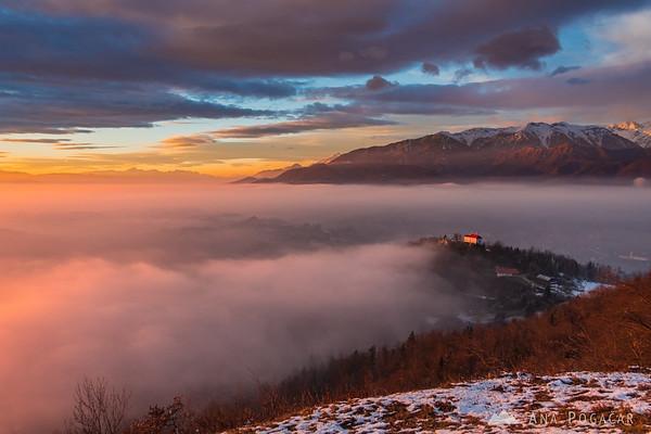 Sunlit mists over Kamnik just before sunset from Špica