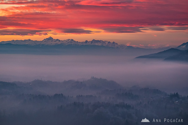 Mt. Triglav and the Julian Alps rising above mists at sunset