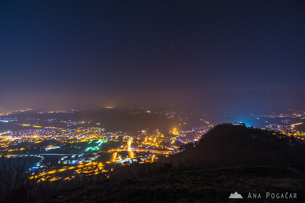 Views of Kamnik from Špica hill on a misty Christmas night