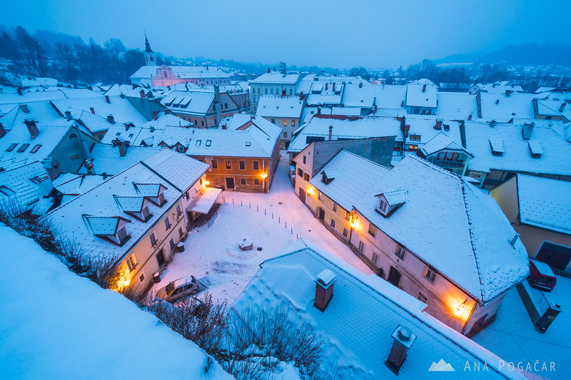 Snowy Kamnik and Mali grad during blue hour