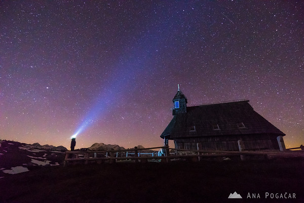 Chapel on Velika planina on a starry night