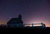 Chapel on Velika planina on a starry night