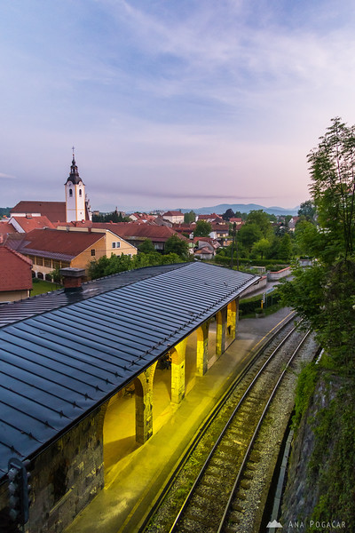 Views towards Šutna church and Zaprice castle from above the Plečnik train station in Kamnik