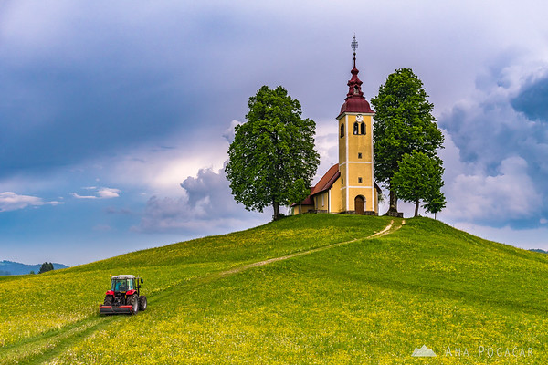 A red tractor and the church in Gorenji Vrsnik