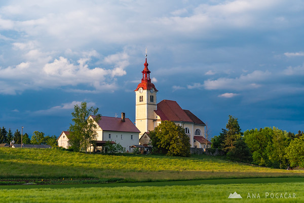 Church in Skaručna in late afternoon light