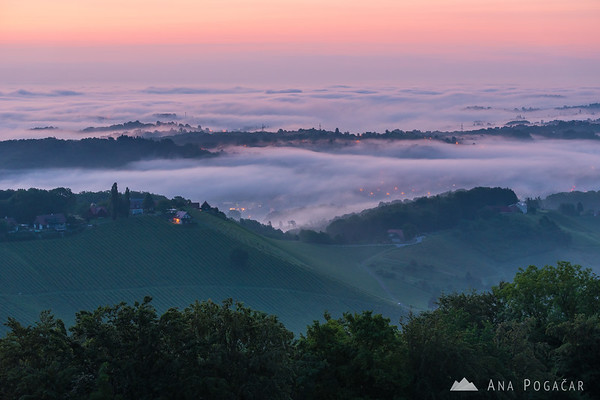 Mists in the hills around the Plač view tower before sunrise