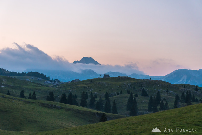 Velika planina and Mt. Ojstrica in a cloud at dusk