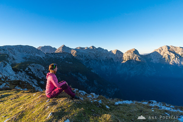 Ana at the top of Kompotela admiring the view of the Kamnik Alps