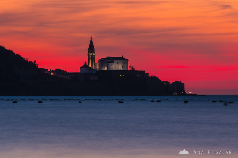 Piran church after sunset as seen from Strunjan